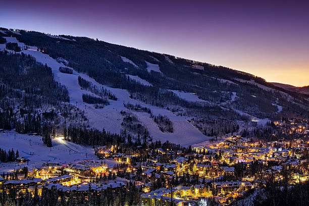 Dusk in Vail Colorado Dusk in Vail Colorado - View of ski slopes and Vail Village in Vail, Colorado.  Winter landscape with scenic view. vail colorado stock pictures, royalty-free photos & images