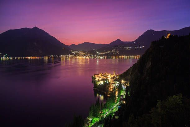 dusk looking over varenna on lake como, italy - lake como stock photos and pictures