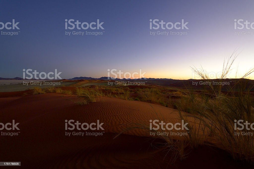 Dusk over a big red dune royalty-free stock photo