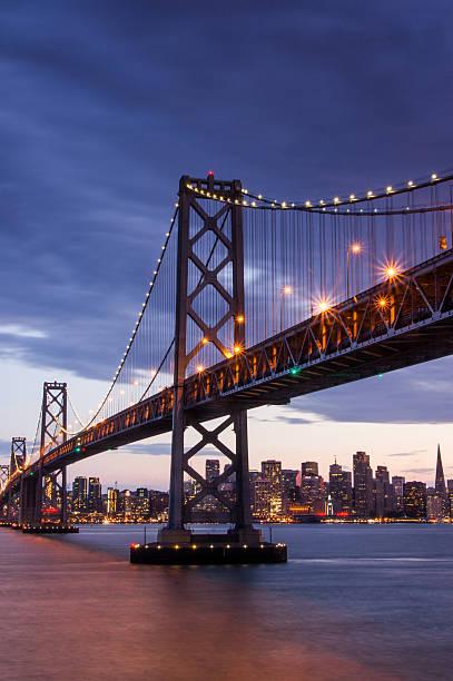 Dusk over Bay Bridge and San Francisco Skyline stock photo