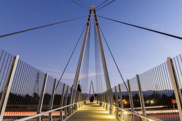 Dusk over Don Burnett Bicycle-Pedestrian Bridge (aka Mary Avenue Bicycle Footbridge). Cupertino, Santa Clara County, California, USA. footbridge stock pictures, royalty-free photos & images