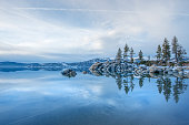 The winter landscape of a frozen Lake Tahoe on the California side.