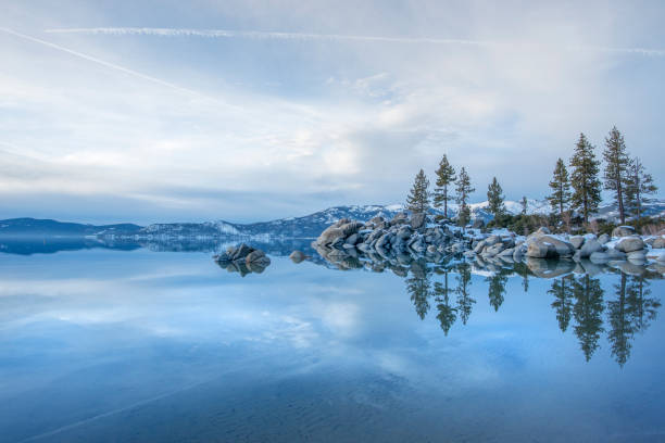 Dusk Over the Frozen Landscape of Lake Tahoe in Winter The winter landscape of a frozen Lake Tahoe on the California side. national forest stock pictures, royalty-free photos & images