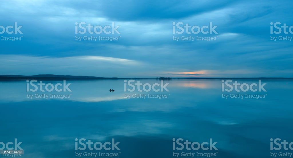 Dusk with reflection of cloudscape on water surface of lake Steinhuder Meer royalty-free stock photo
