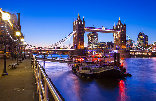 Dusk-time View of Tower Bridge in London A beautiful dusk-time view of Tower Bridge and the River Thames in London. bascule bridge stock pictures, royalty-free photos & images