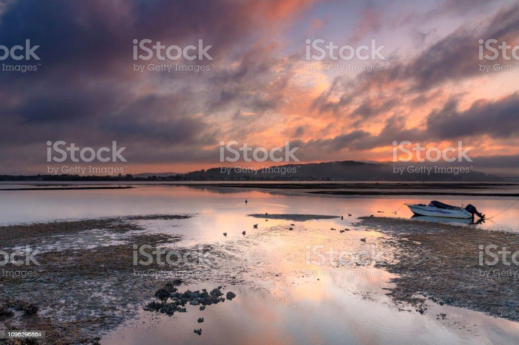 Dusky Pink Sunrise Bay Waterscape stock photo