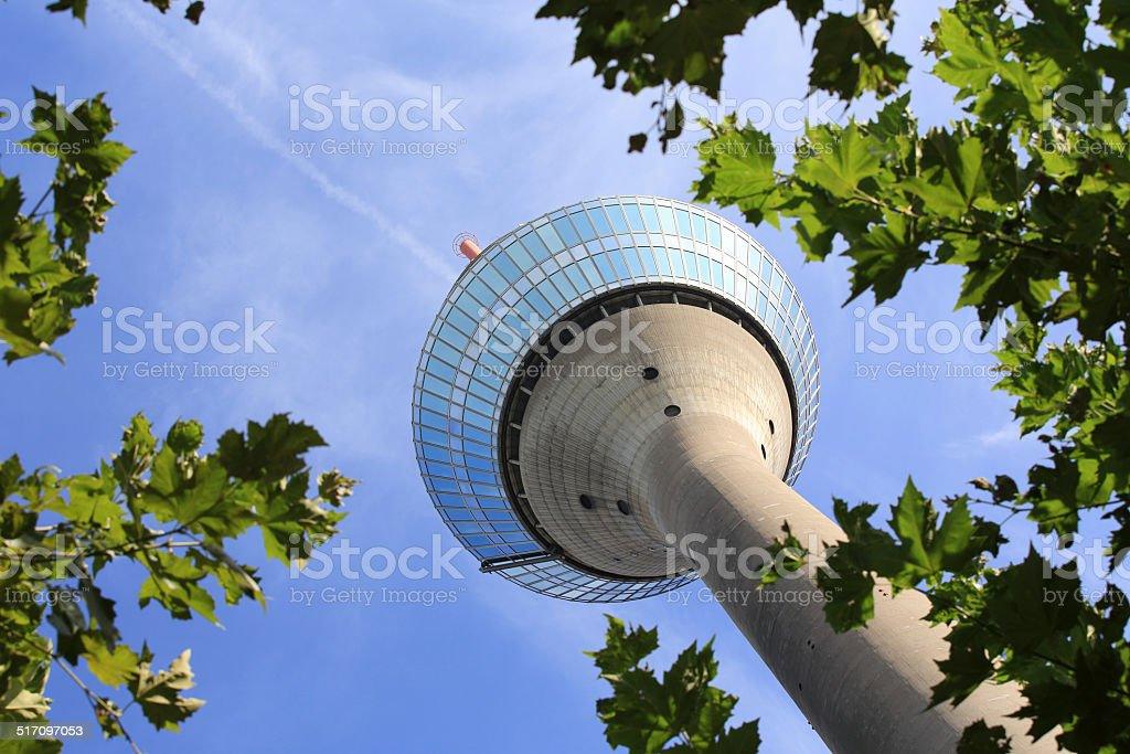 Dusseldorf rhine tower framed by trees stock photo