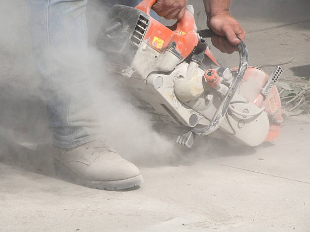 Dust from Cutting Concrete with a Circular Saw  terryfic3d stock pictures, royalty-free photos & images