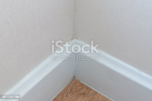 istock dust in the corner of room wall 627232786