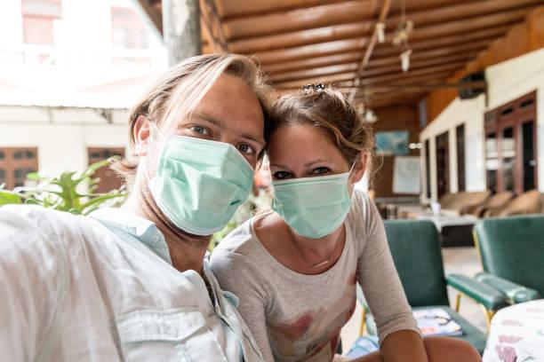 Dust mask selfie Sumatra stock photo