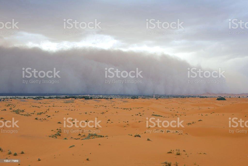 Dust Storm Approaching Merzouga Settlement royalty-free stock photo