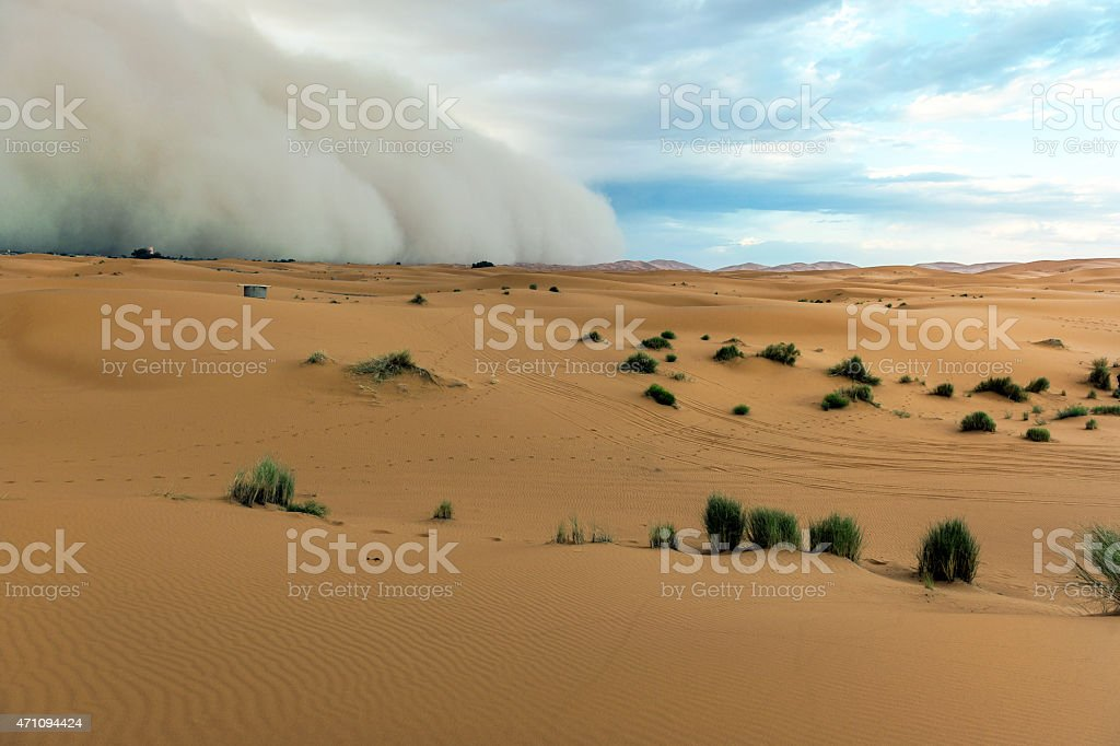 Dust Storm in Sahara Desert Sandstorm approaching, Merzouga, Morroco, Africa. stock photo