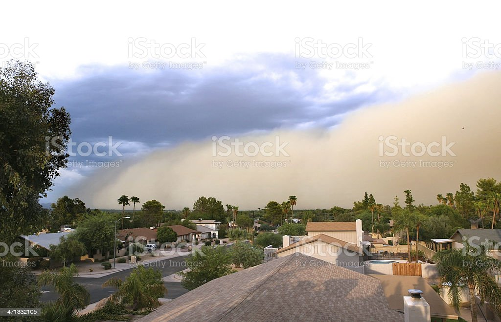 Dust storm rolling over residential area  stock photo