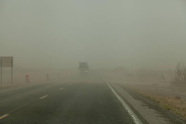 Dust storm slows travel stock photo