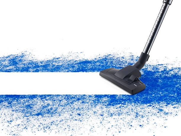 Dust vacuuming Dest vacuum cleaner vacuuming blue dust on white background suction tube stock pictures, royalty-free photos & images