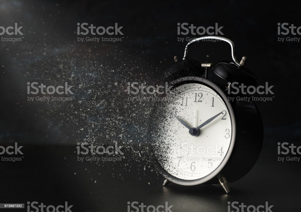 Dust-Disappearing alarm clock stock photo