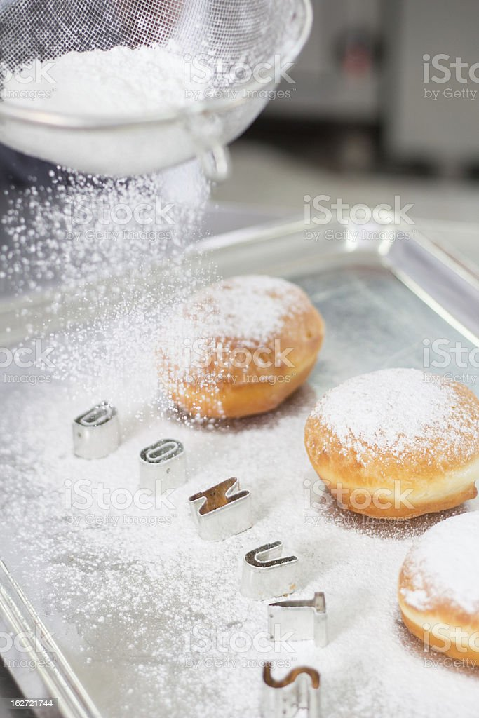 Dusting donuts stock photo