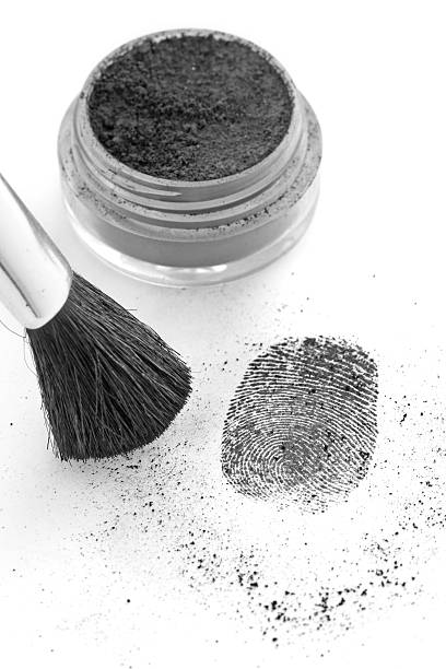 Dusting for fingerprints with a brush stock photo