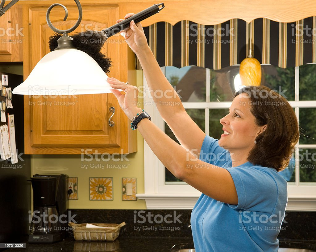 Dusting kitchen lamp stock photo