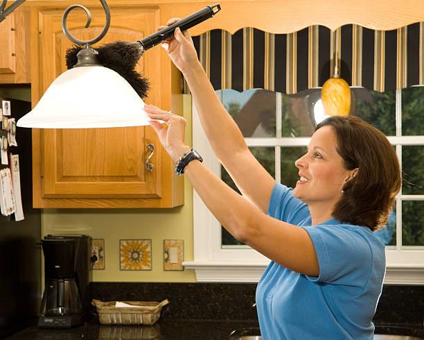 Dusting kitchen lamp stock photo