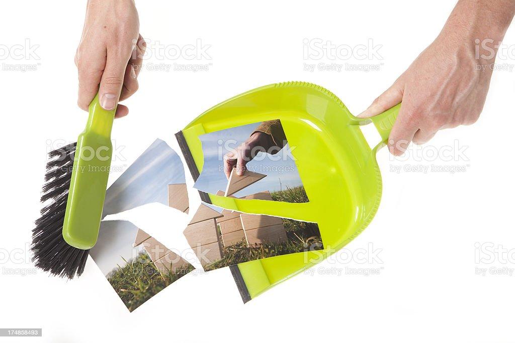 Dustpan and brush, bankrupt royalty-free stock photo
