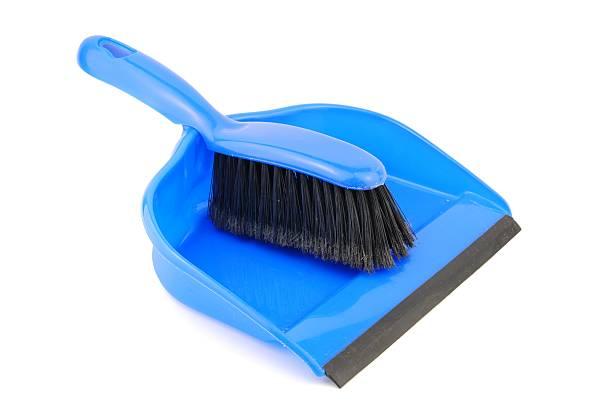 Dustpan and brush on white stock photo