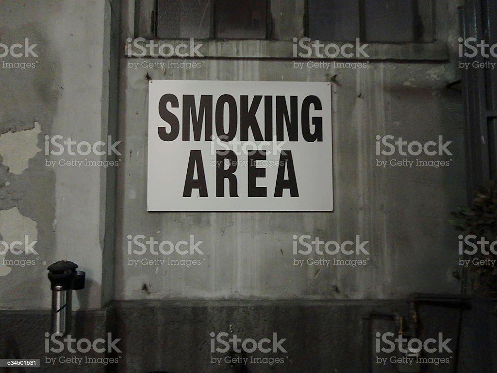 Dusty alternative urban smoking area stock photo