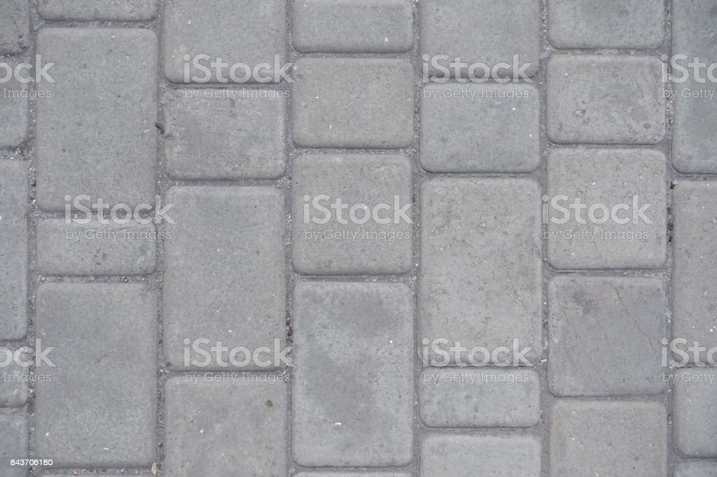 Dusty grey pavement made of concrete blocks stock photo