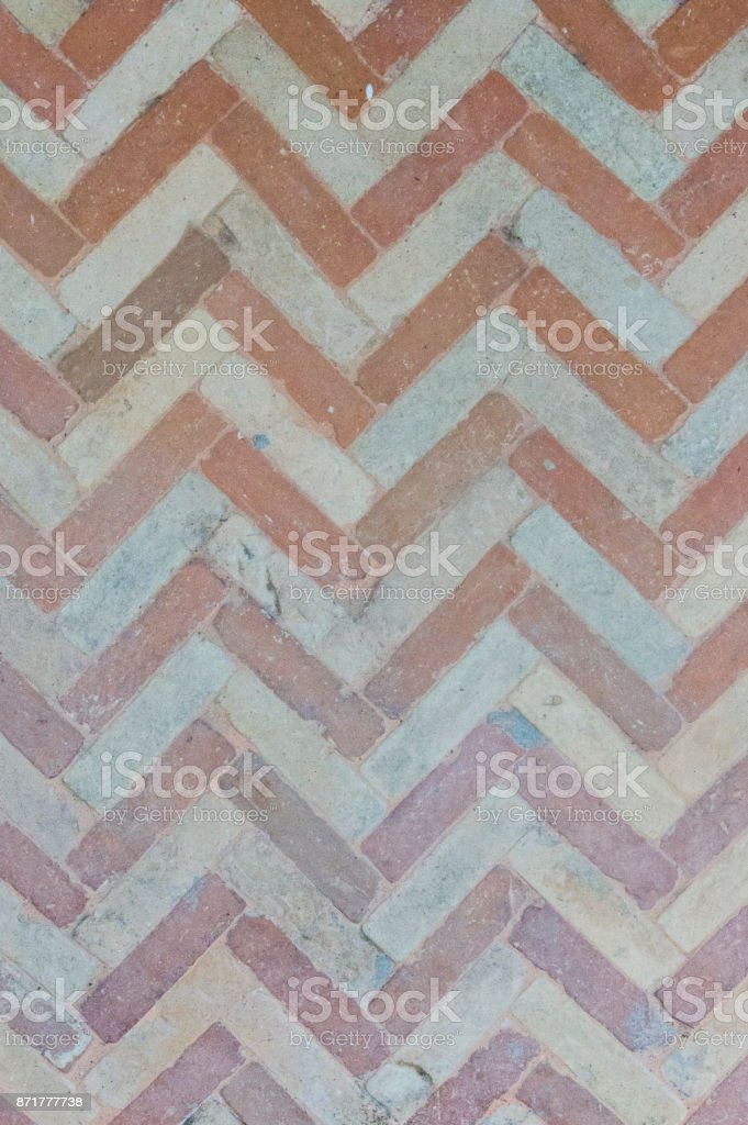 Dusty herringbone or zigzag pattern, ancient wall stock photo