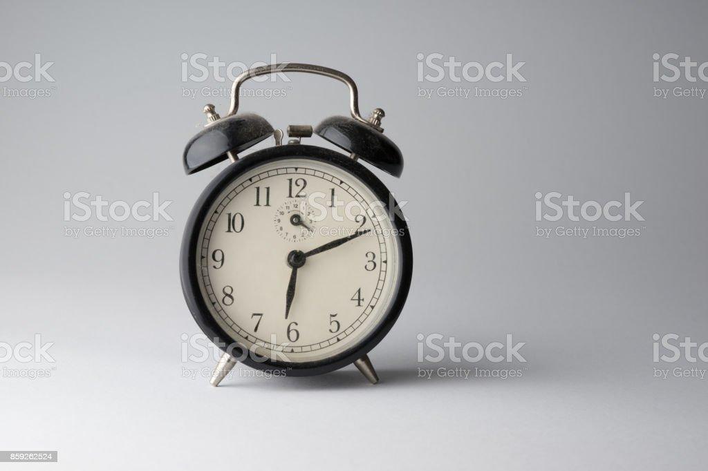 Dusty old alarm clock stock photo