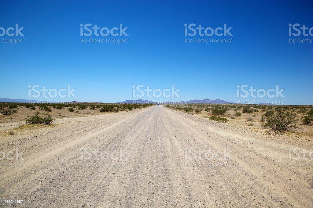Dusty Road in California Mojave Desert royalty-free stock photo