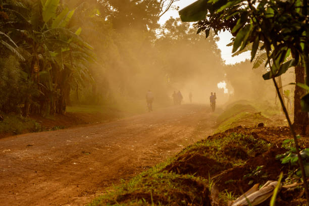 Dusty road A very dusty road around the Sipi falls in the Mount Elgon national park in Uganda east africa stock pictures, royalty-free photos & images