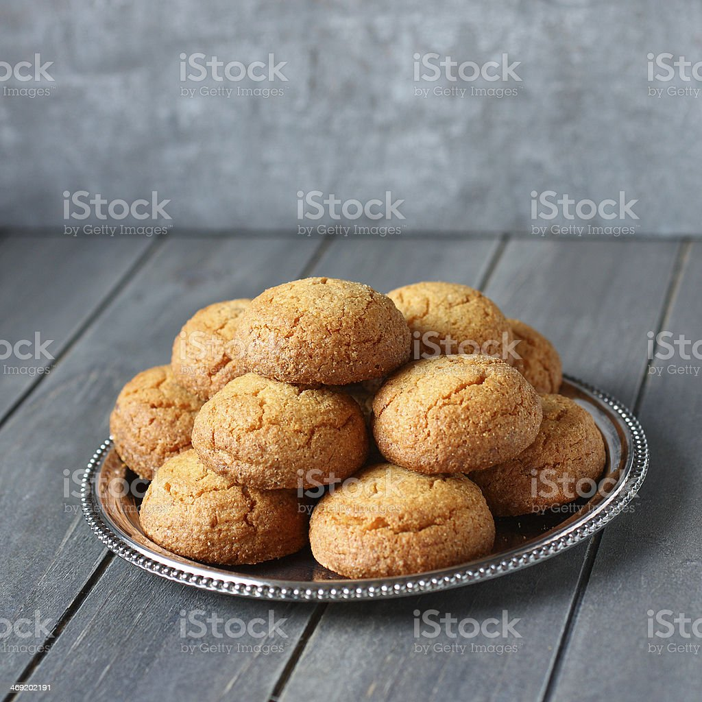 Dutch almond cookies called 'bitterkoekjes' on metal plate stock photo