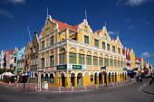 Willemstad, Curacao - March 7, 2011: The Penha Building in the old district of Punda is a fine example of 18th century Dutch colonial architecture in Curacao.