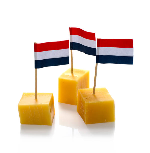 dutch cheese cubes isolated on white stock photo