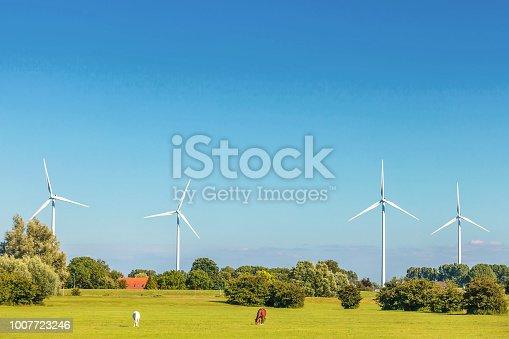 Dutch farmland with four windmills in Gelderland near Arnhem, The Netherlands