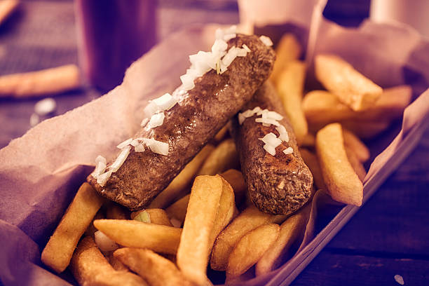dutch fast food culture frikandel mit pommes frites - buletten stock-fotos und bilder