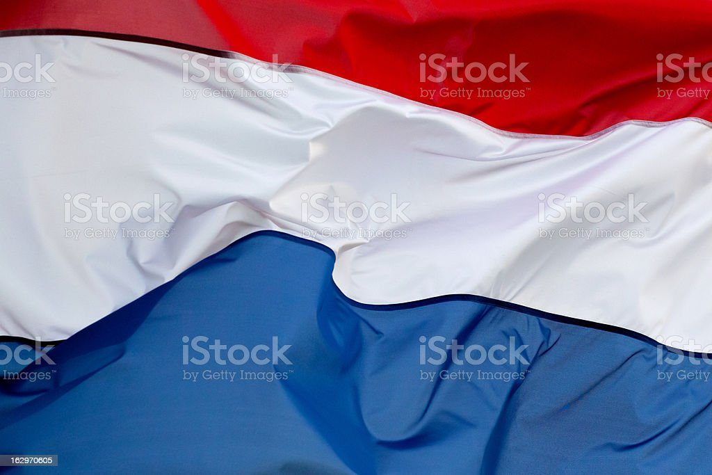 Bandera holandesa en el viento - foto de stock