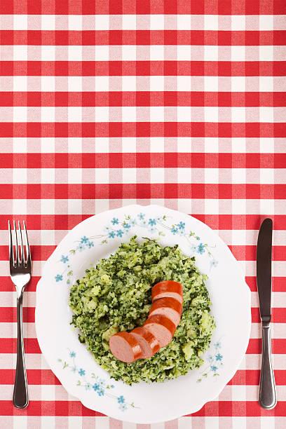dutch food: kale with smoked sausage or 'boerenkool met worst' - stamppot stockfoto's en -beelden