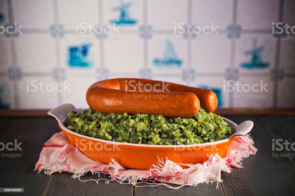 Dutch food: kale with smoked sausage or 'Boerenkool met worst' stock photo