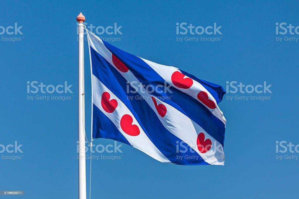 Dutch Frisian flag against a clear blue sky stock photo