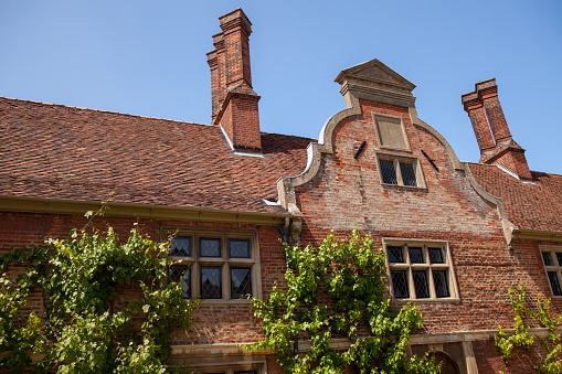 Dutch gable roof. Architectural detail on period red brick building