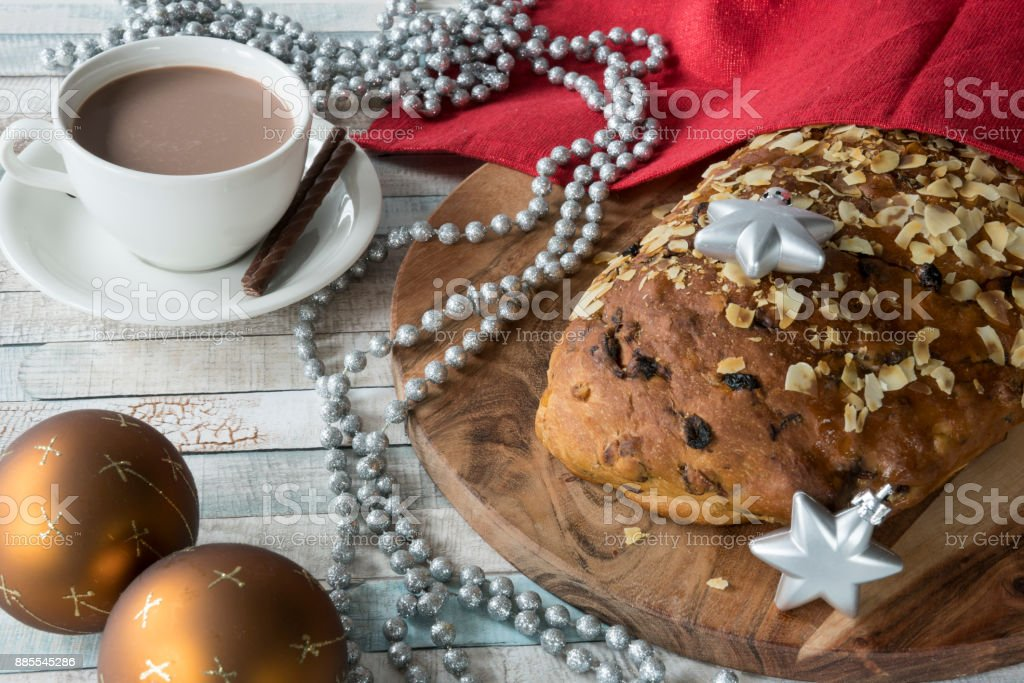 Dutch German Christmas breakfast with coffee, typical bread, kerststol and decorations stock photo