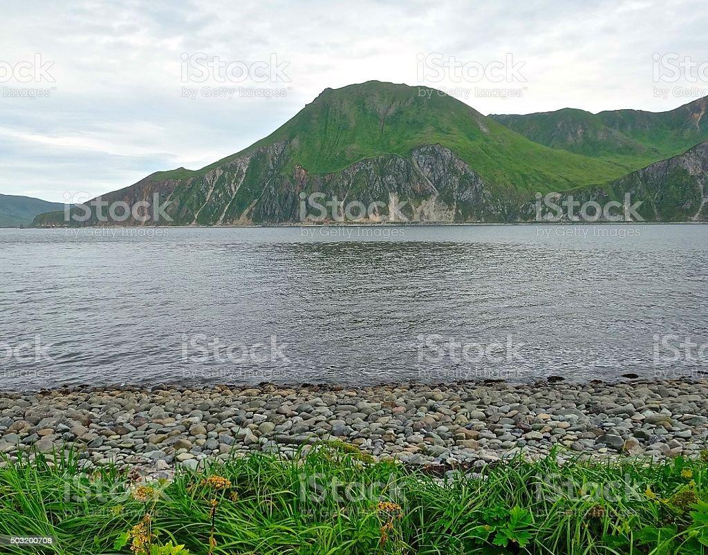 Dutch Harbor, Alaska seashore and mountains stock photo