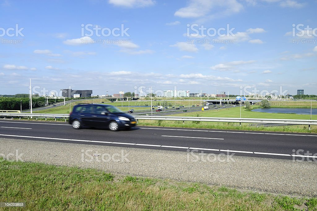 Dutch highway and city skyline royalty-free stock photo