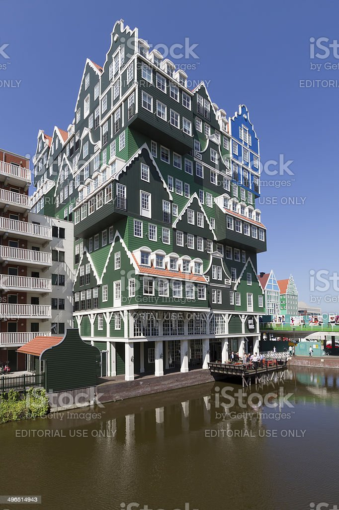 Dutch hotel with multiple facades of green wooden houses stock photo