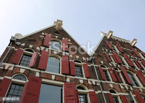 Dutch house facades and under the roof the protruding hook to lift the furniture during removals