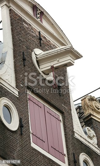 Dutch house facades and under the roof the protruding hook to lift the furniture while moving