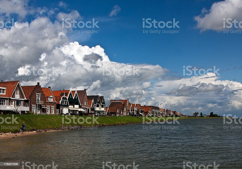 Dutch houses along dyke royalty-free stock photo