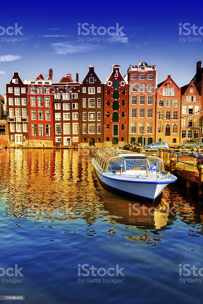 Dutch Houses, Boat and Canal in the Center of Amsterdam stock photo